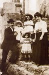 The Santini family at the Vesta temple, near the house. 1910. Little Pio in his fathers-arms.jpg